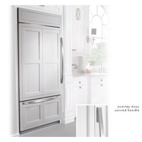 Built in refrigerator with a framed cabinet style overlay