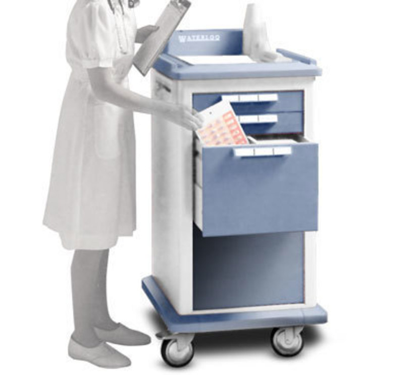 Three quarters front view of the small medical cart with a user standing next to it