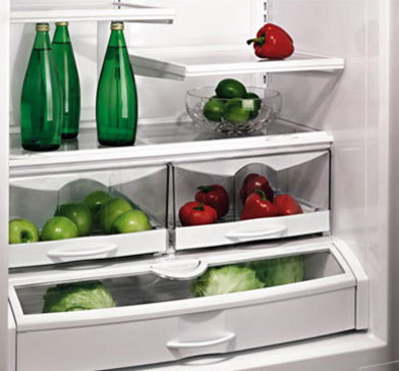 Three quarters front view of the production version showing produce and water in the refrigerator