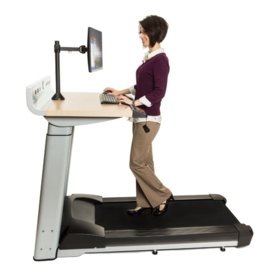 Side view if the InMovement TreadMill Desk showing a person using it