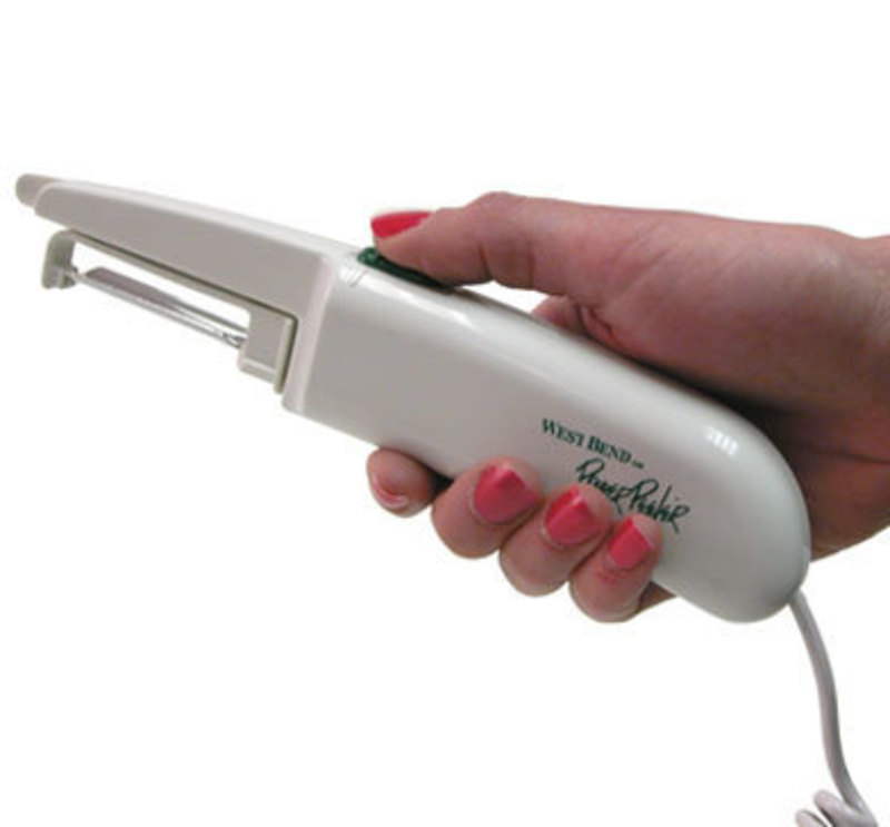 Side view of the Power Peeler in a user's hand