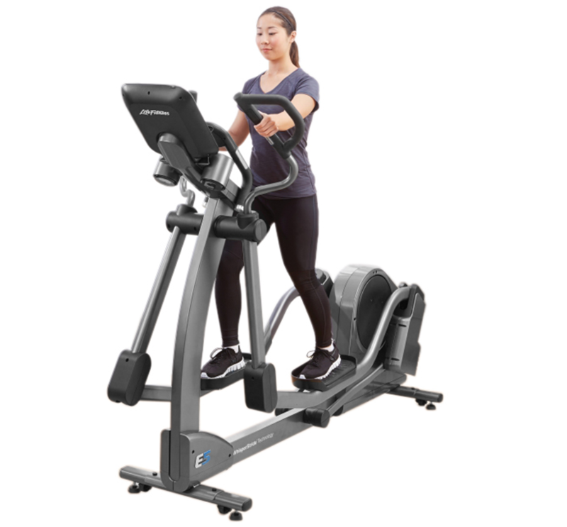 Three quarters view of an e-series elliptical with a person using it