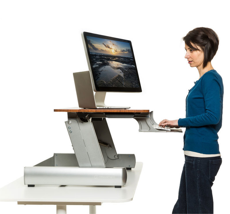 Side view of the InMovement desktop with a person using it on a desk