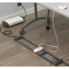 In context view of the Juice Mobile Power system integrated into a room and table