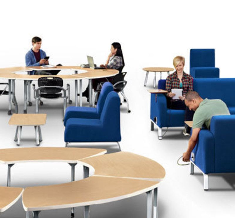In context view showing people in Motiv soft chairs and using modular tables